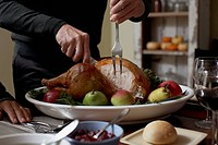 Man carving a roast turkey
