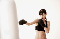 Woman punching punching bag