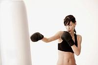 Woman punching punching bag