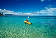 Woman heads out in a kayak at Napili Bay, Maui, Hawaii