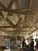 New Inn and Visitors Centre, Stowe, Buckingham, United Kingdom. Architect Cowper Griffith Architects, 2012. Interior of visitors centre shop.