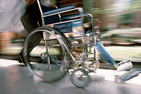 Hospital Staff Running with Wheelchair