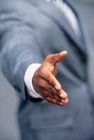 Businessman with Hand Outstretched for Handshake