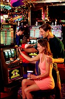 Couple playing the slot machines