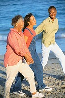 Mothers and Daughters Strolling on Beach