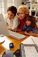 Mother and Children Using Computer