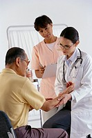 Doctor Checking Man´s Pulse