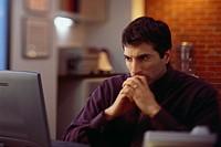 Concerned Man Staring at Computer