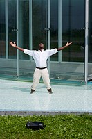 Businessman in the pool outside his office, he could be excited beacuse he has just resigned