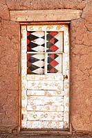 Decorated Door and Adobe Building, Taos Pueblo aka Pueblo de Taos, Taos, New Mexico, USAThe multi_storied adobe buildings at Taos Pueblo have been con...