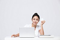 Businesswoman Holding A Credit Card In Office