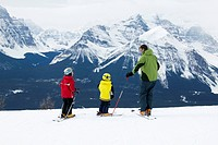 Family on Skiing Holiday in Mountains