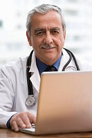 Hispanic doctor using laptop