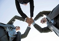 Business team joining hands to celebrate their success