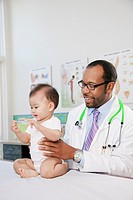 Doctor examining baby in doctor´s office