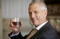 Businessman holding a drink