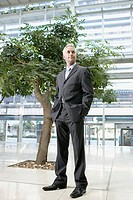 Businessman Standing Near Tree