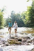 Couple Wading Down Stream