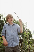 Boy Holding Stick