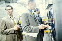 Businesspeople Buying Tickets at Subway Station