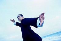 Man Stretching Arms in Tai Chi Movement