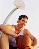 Man Sitting Holding Basketball