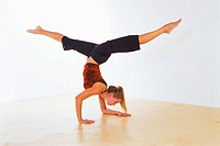 Woman Doing Yoga Scorpion Pose