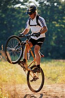 Man Balancing on Mountain Bike