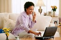 Woman with Laptop Discussing Finances
