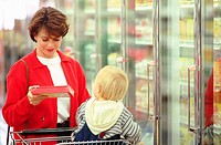 Woman grocery shopping with child