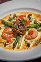 Green asparagus and fresh fried Japanese mushrooms, served with a duxelle roulade, and gratinated in a fontina and white truffle sauce with sauteed pr...