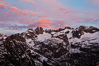 Sunrise in the early morning sky above the mountains of Fuenffingerstoecke, at Sustenpass, Alpen, Switzerland