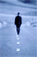 Businessman Walking Down the Road Alone