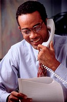 Cheerful Businessman on the Phone