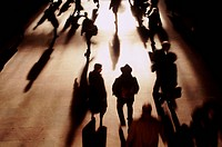 Silhouetted commuters