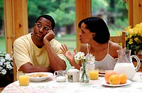 Couple having an argument at breakfast