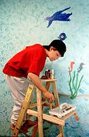Artist painting his bedroom walls
