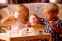 Children Playing with Tea Set