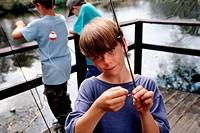 Boy Hooking a Worm