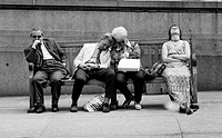 Four People Resting on Street Bench