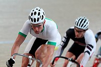 Cyclists Competing On Racing_Track