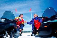 Family on snowmobiles