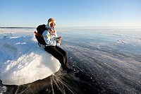Woman sitting on ice