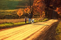 Father with his daughter on a country road