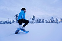 Woman snowshoeing in Winter landscape