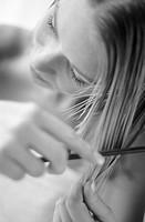 Combing her hair