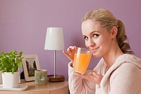 Woman with vitamin drink
