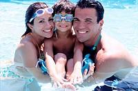 Pool portrait with his parents