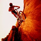 Man Mountain Biking on Sandstone Rocks