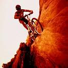 Man Mountain Biking on Sandstone Rocks